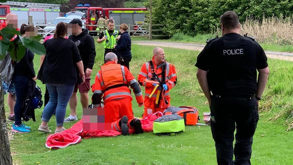 Injured: Paramedics attend to a boy who fell from a rollercoaster at Lightwater Valley theme park PICTURE: GETTY