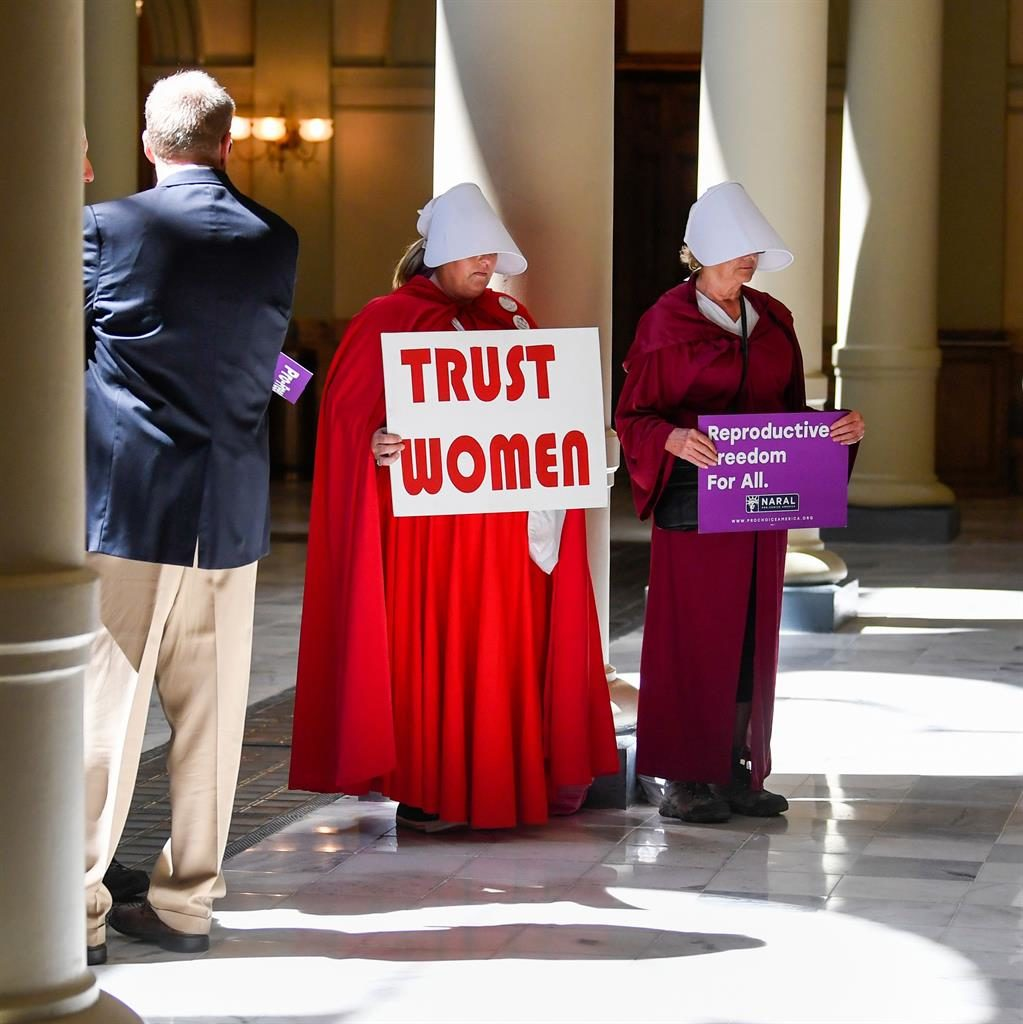 Protest: Pro-choice activists dressed as characters from The Handmaid's Tale at the State Capitol building in Atlanta PICTURE: AFP