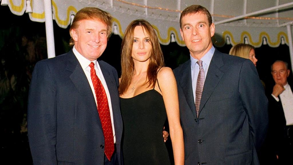 Teeing off: Donald Trump and Melania first met Prince Andrew in 2000 PICTURE: GETTY