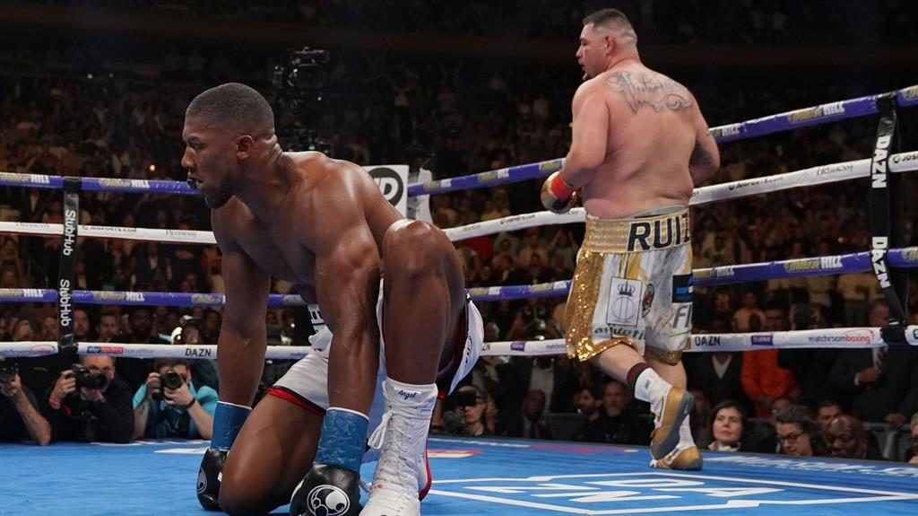 Down and out: Joshua is floored in the seventh by Ruiz on his way to defeat in New York PICTURE: AFP/GETTY