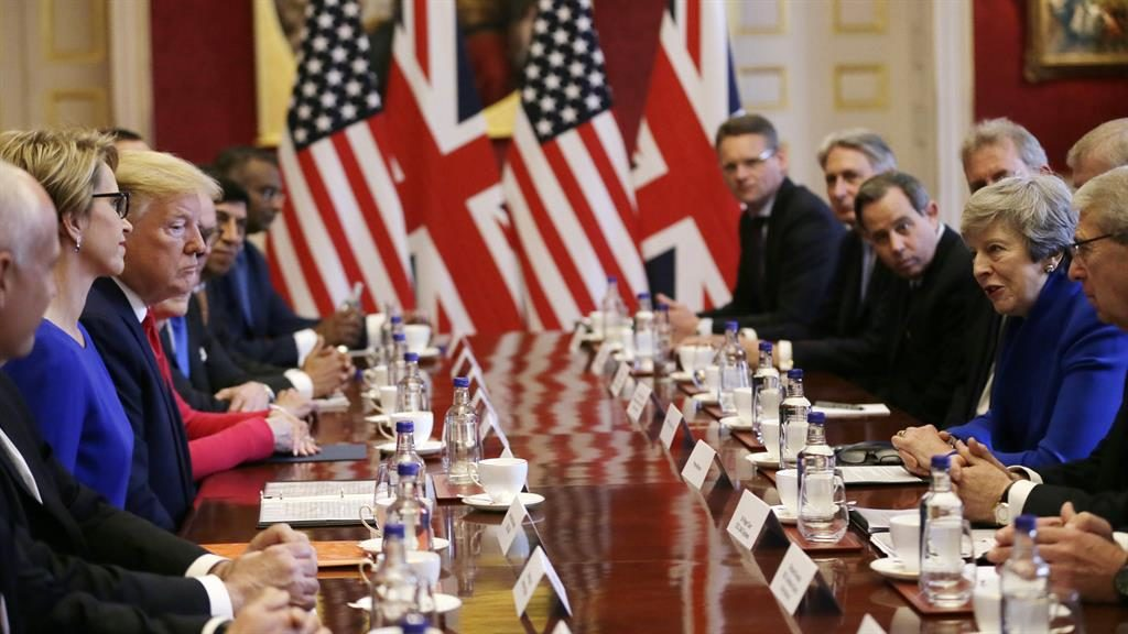 Money talks: Mr Trump and Mrs May host a business meeting, also attended by chancellor Philip Hammond PICTURES: GETTY/PA/REX
