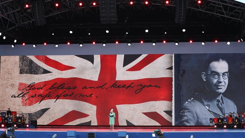Sadness: Captain Norman Skinner's words are projected on to the Union Flag as Mrs May reads PICTURES: GETTY/AP