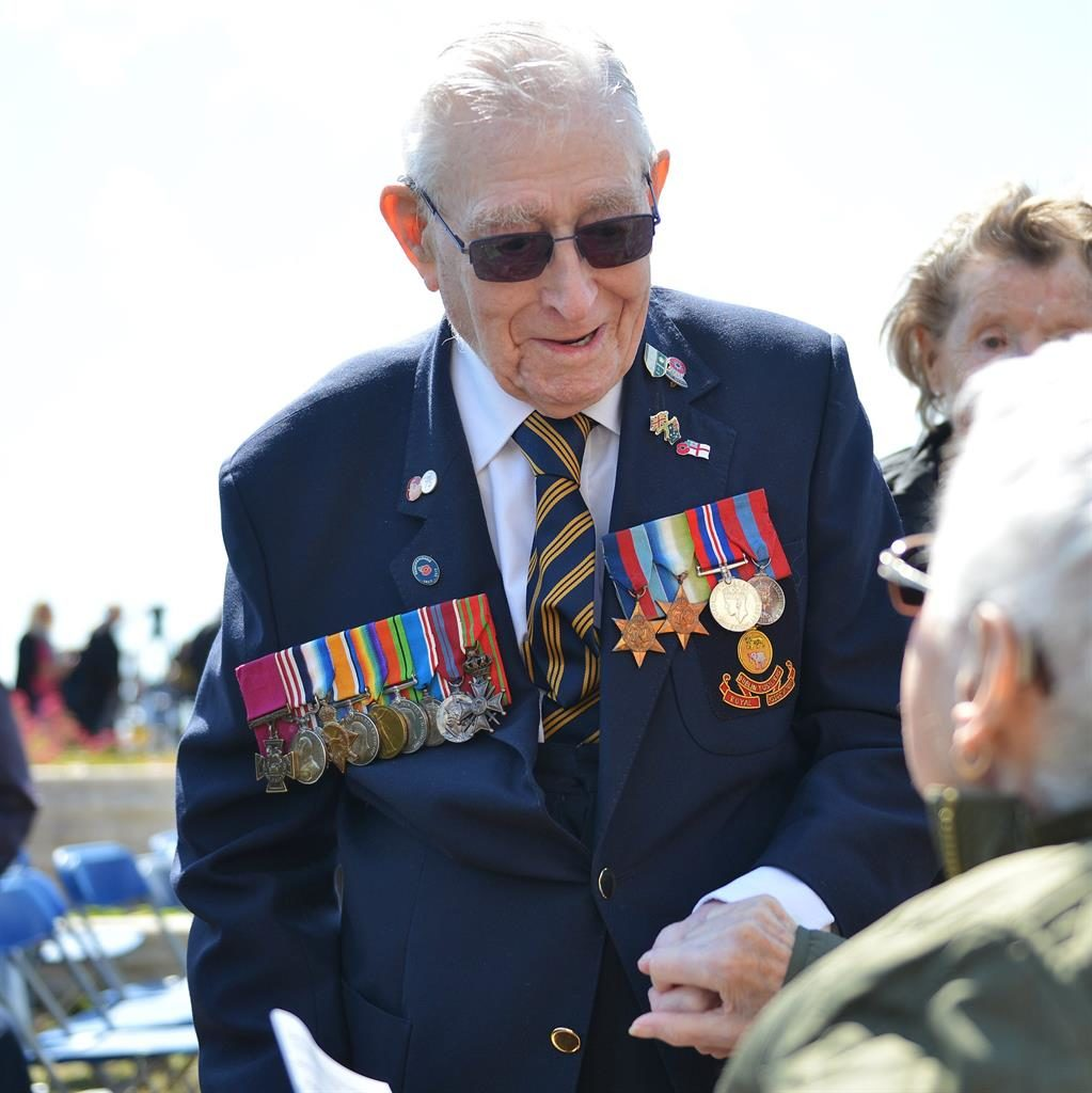 Pride: Mr Ockendon with his medals and his dad's PICTURE: SOLENT