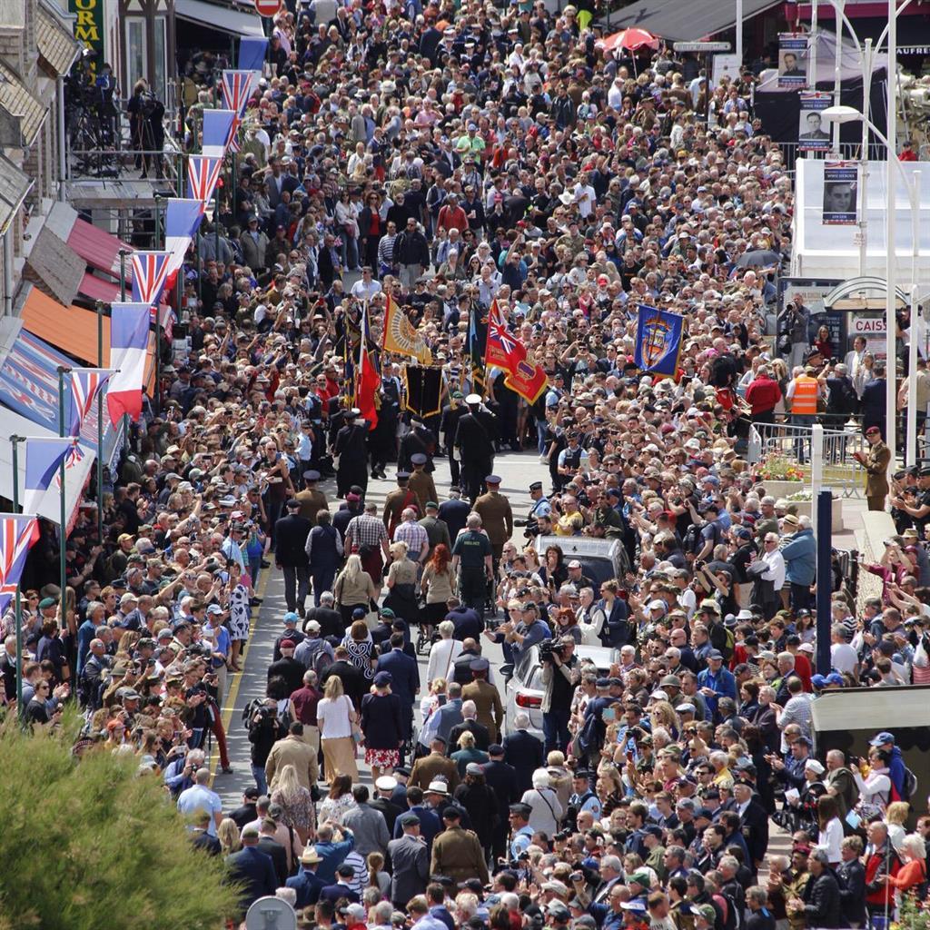 Show of gratitude: Thousands watch the veterans march through Arromanches PICTURES: MoD/PA/EPA/ALAMY