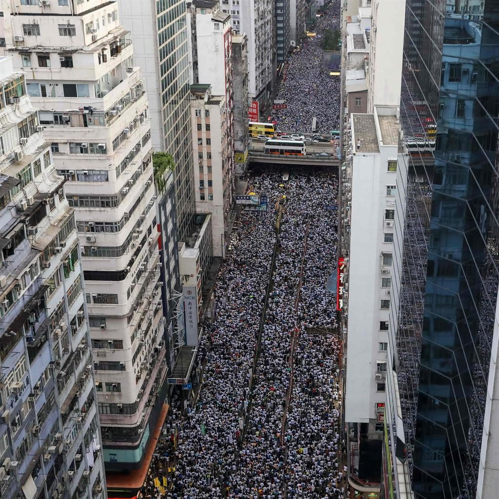 Great white hope: An estimated 500,000 protesters, mainly dressed in white, marched in Hong Kong PICTURE: AFP/GETTY