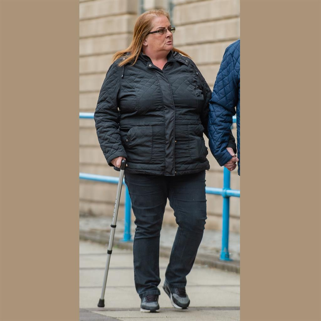 Limp excuse: Rebecca Peach, 49, arriving at court on Friday PICTURES: SWNS