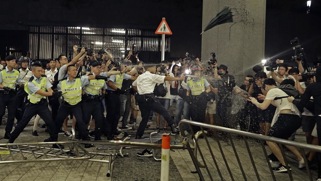 Anger: Police use pepper spray on protesters PICTURE: AP
