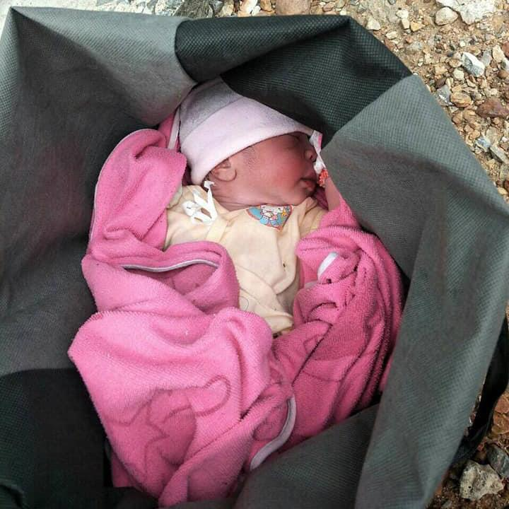 Recovered: The baby was found left in a bag PICTURES: VIRAL PRESS