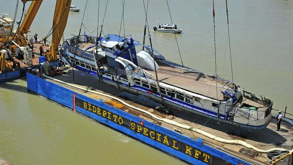 Crane: Tour boat is lifted out of Danube, Budapest, 12 days after the collision PICTURE: AP