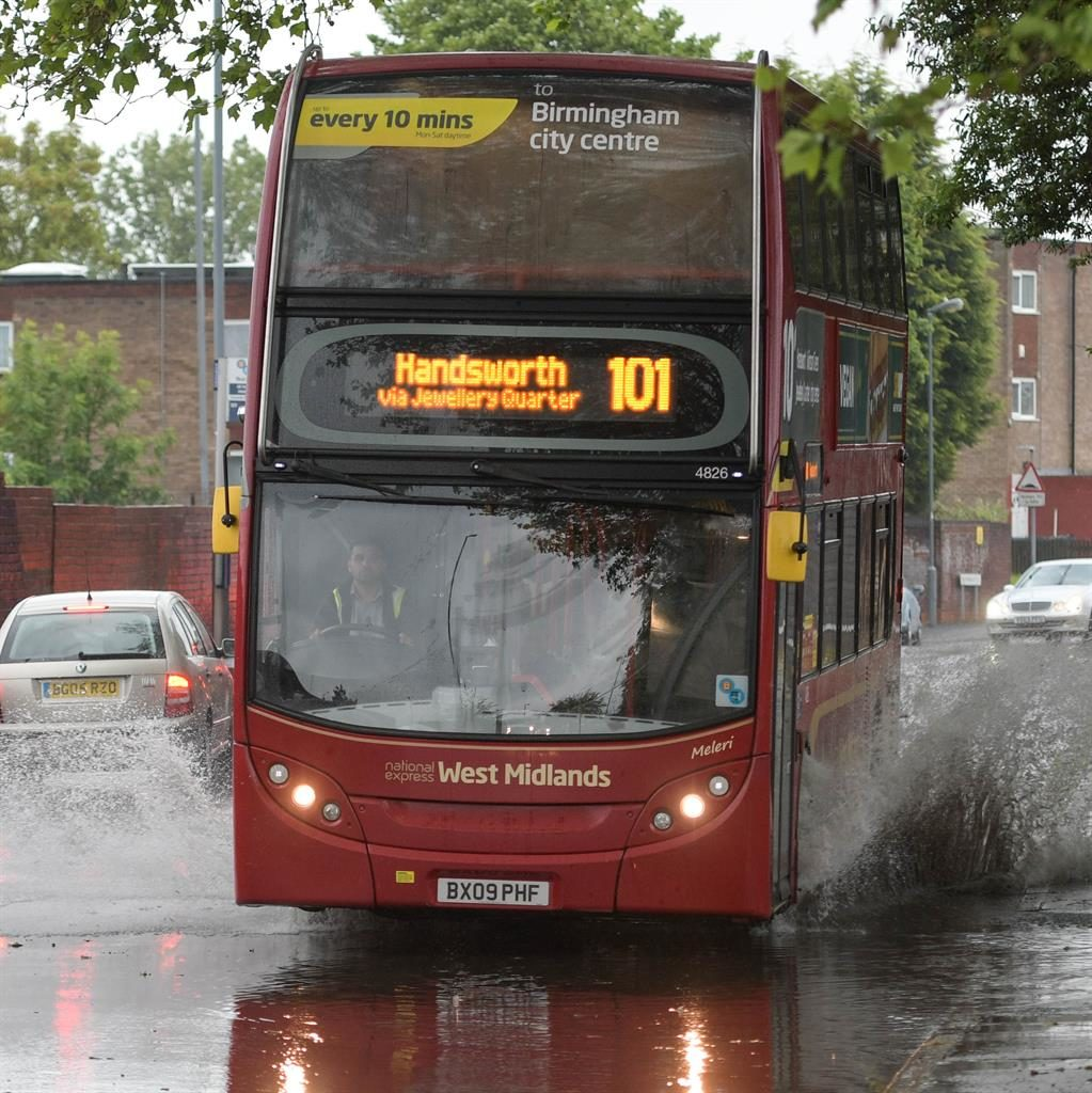 The Wet Midlands: A bus in Birmingham PICTURES: CATERS/PA/REX/SWNS/KENT POLICE/EMMA HARRISON