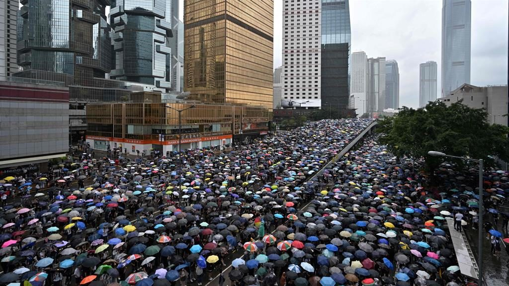 Umbrella movement: Crowds shelter from the rain in the largest protest since major sit-ins in 2014 PICTURE: AFP