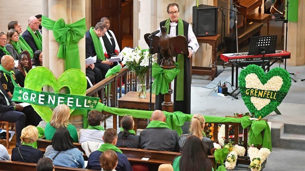 Time to remember: Dr Graham Tomlin, the Bishop of Kensington, speaks at a service of remembrance which took place at St Helen's Church in London to mark the two-year anniversary of the Grenfell Tower fire PICTURE: PA