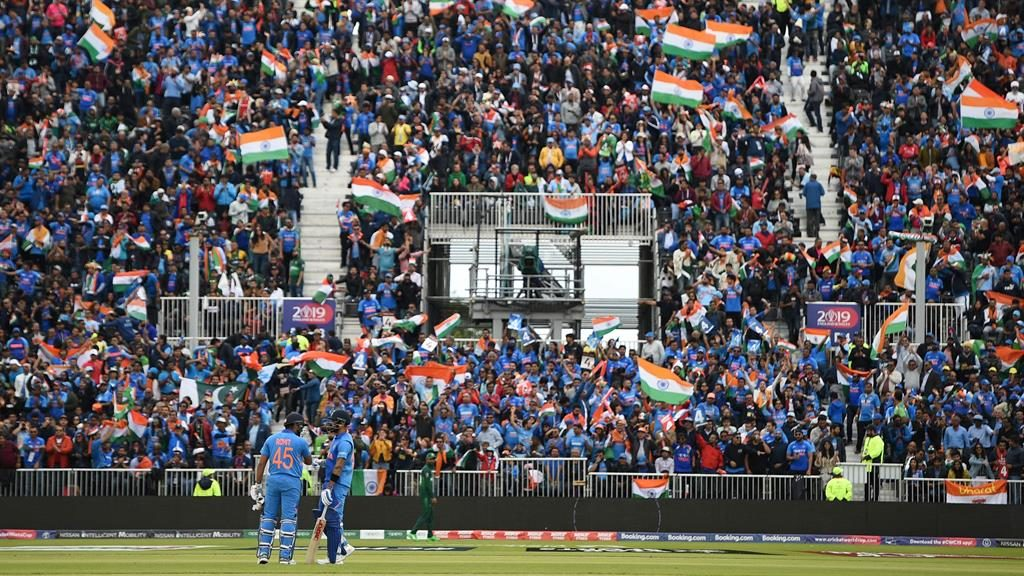 Indian summer: Batsmen Rohit (left) and Kohli discuss their approach in front of a wall of fans at Old Trafford PICTURE: AFP
