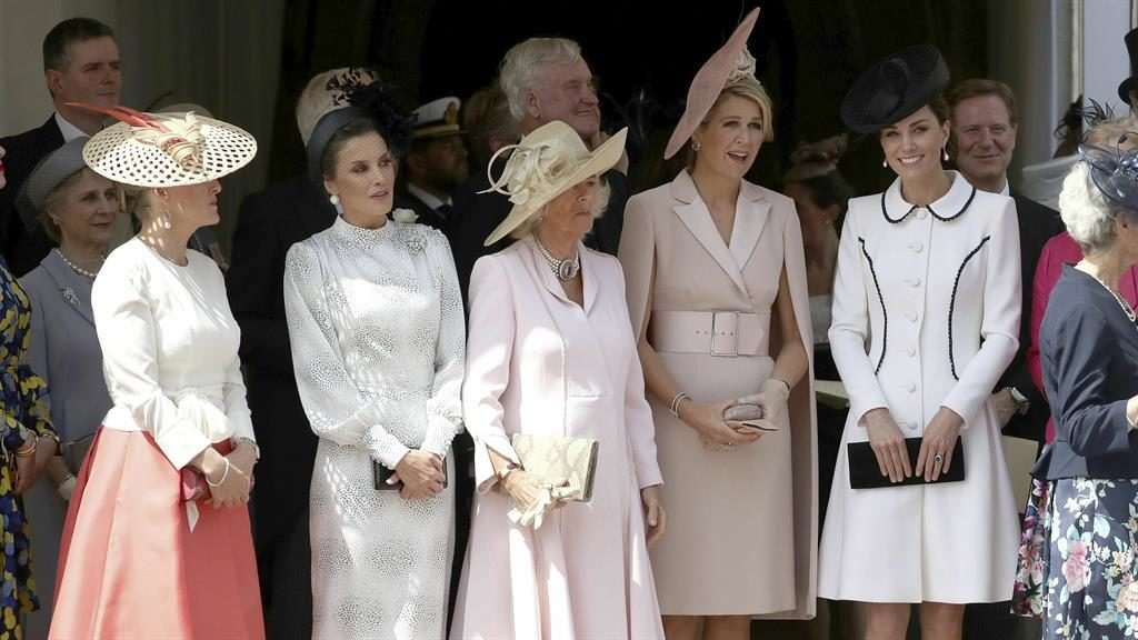 Plume with a view: Sophie, Letizia, Camilla, Maxima and Kate watch ceremony PICTURE: AP