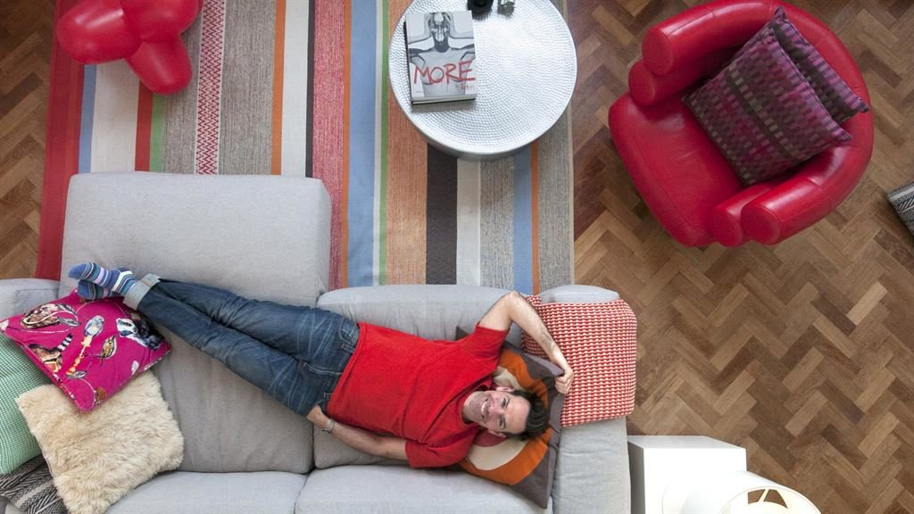 Lounge lover: David and partner Hannah have added quirky touches to their home, including great lighting, below