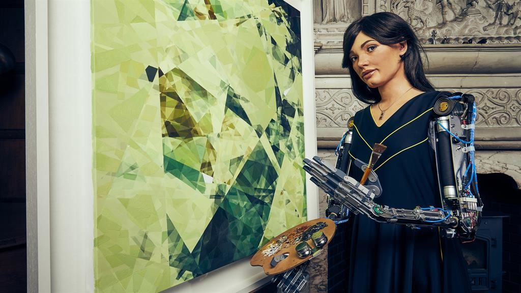 Picture this: Ai-Da next to a human artwork inspired by her data PICTURE: PA