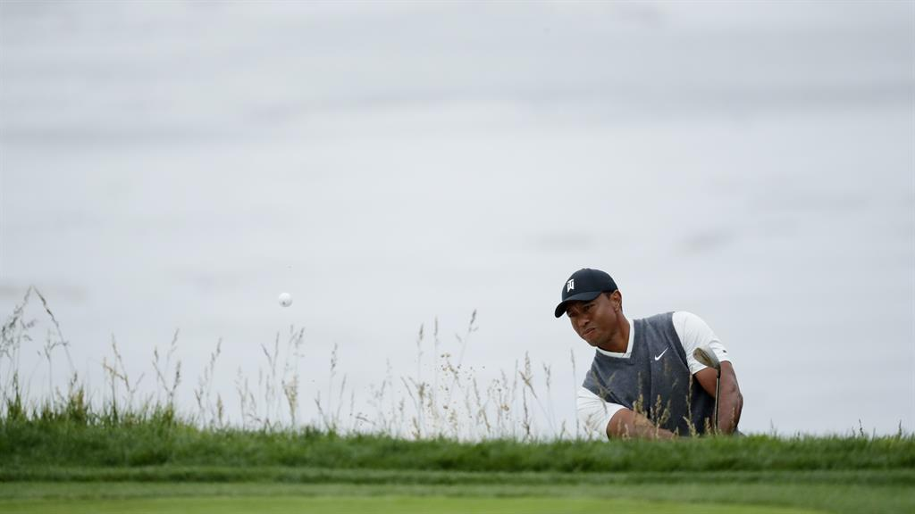 tiger woods eyes another major title as justin rose takes