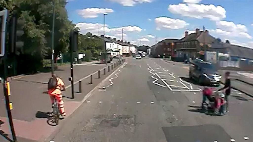 Mind how you go: The cyclist crashed into the lampposts after ignoring a red light PICTURES: SWNS