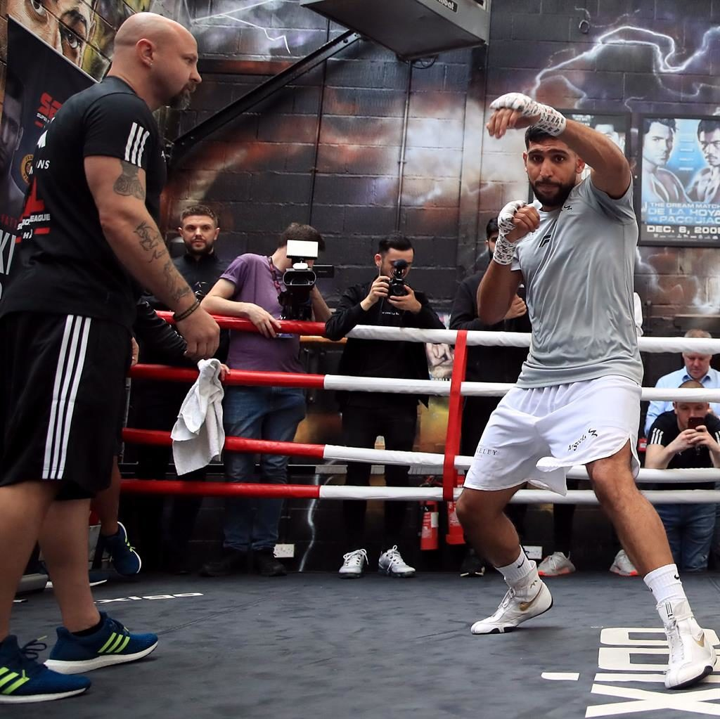 New charge: Bones Adams with Amir Khan at a media workout last month PICTURE: PA
