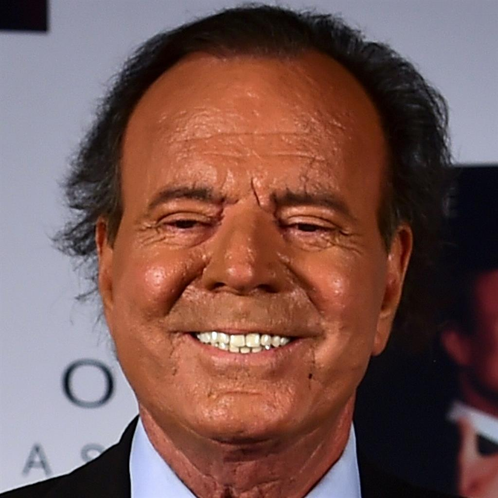 He's the daddy: Julio Iglesias, and (below) 'biological son' Javier Sanchez with mum Maria Edite Santos PICTURES: AFP/GETTY