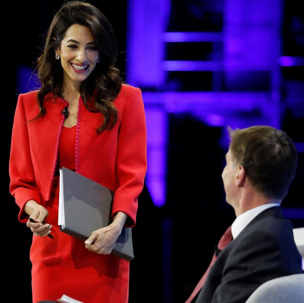 Summit: Amal Clooney at the London conference, co-hosted by Jeremy Hunt PICTURE: GETTY