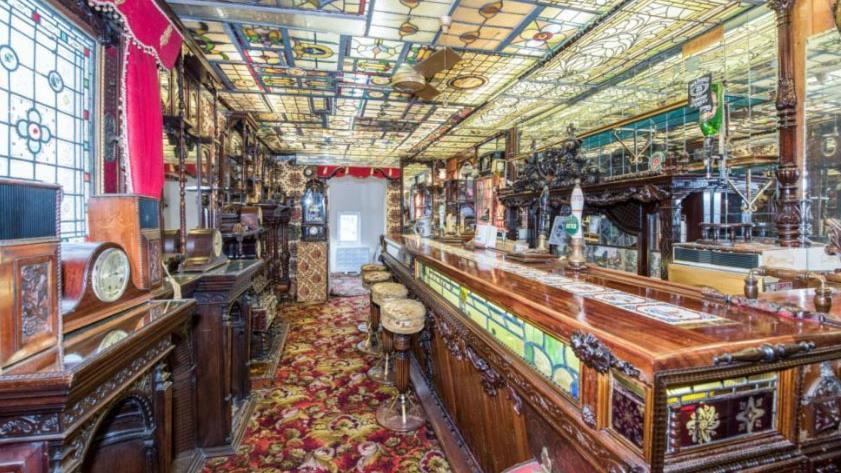 Available to brew: Built-in boozer and (below) the £800,000 house from outside PICTURE: RIGHTMOVE