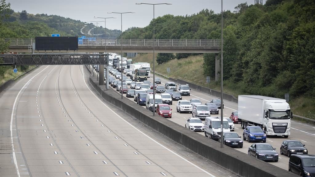 Chaos: Long queues on the M25, after lorry crash (below) PICTURE: LNP