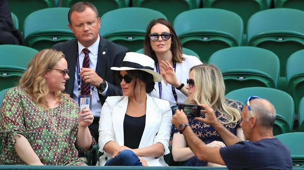 Innocent picture: Mr Hasanov taking a selfie with Meghan and her friends in seats behind his. The duchess's bodyguard hasn't quite noticed at this point PICTURES: MIKE EGERTON/PA WIRE