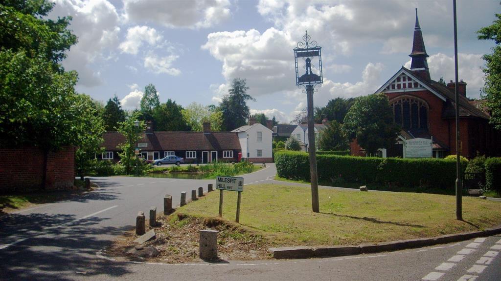 Village life: Mill Hill Village boasts superb view (below)