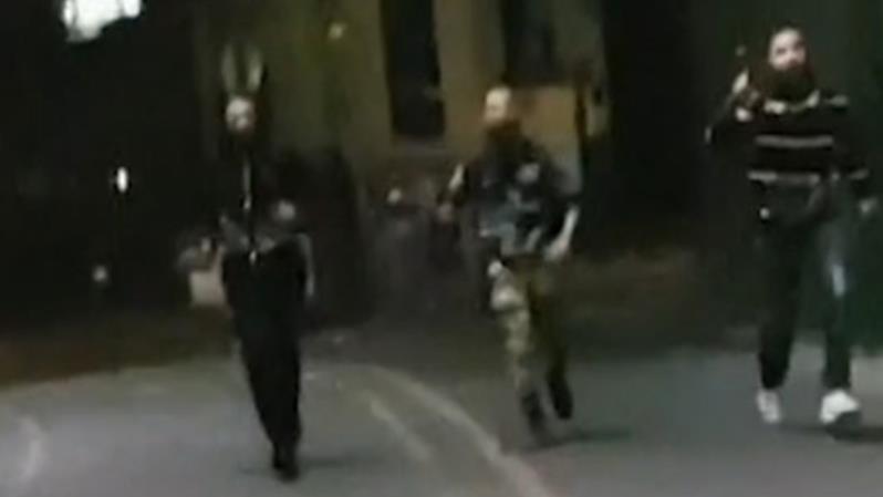 Murderous intent: Attackers head towards unarmed cops