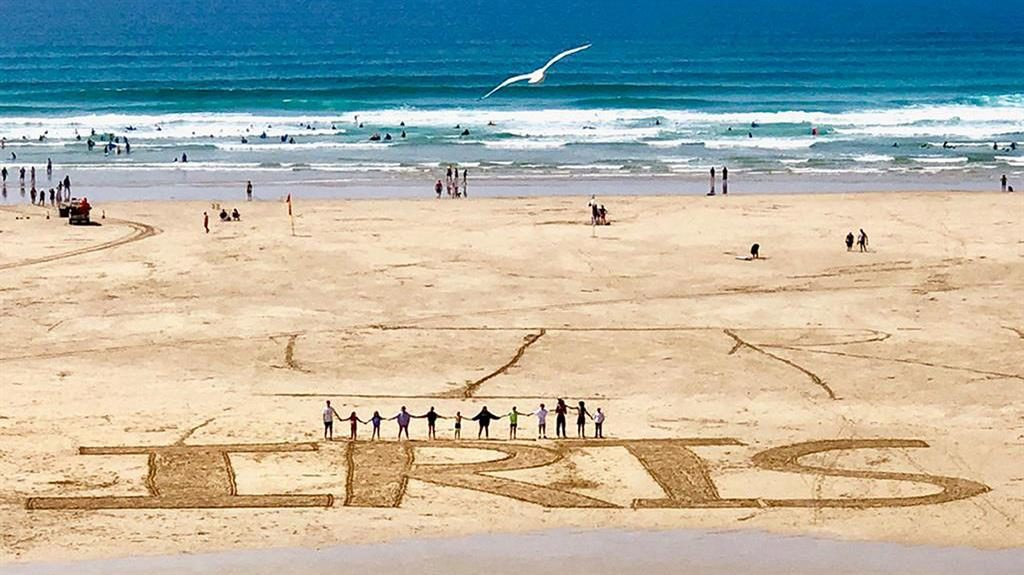 Touching: Tribute on a beach for 15-year-old Iris Goldsmith PICTURE: PA