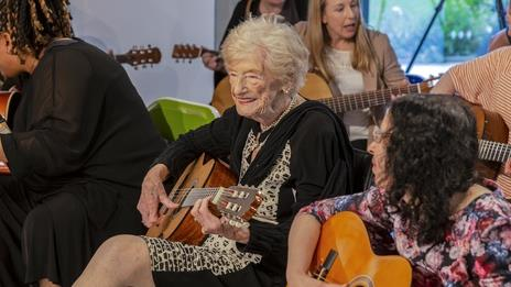Never too late: Mary, 97, has learned to play the guitar as part of a charity campaign endorsed by Stevie Wonder PICTURE: SWNS