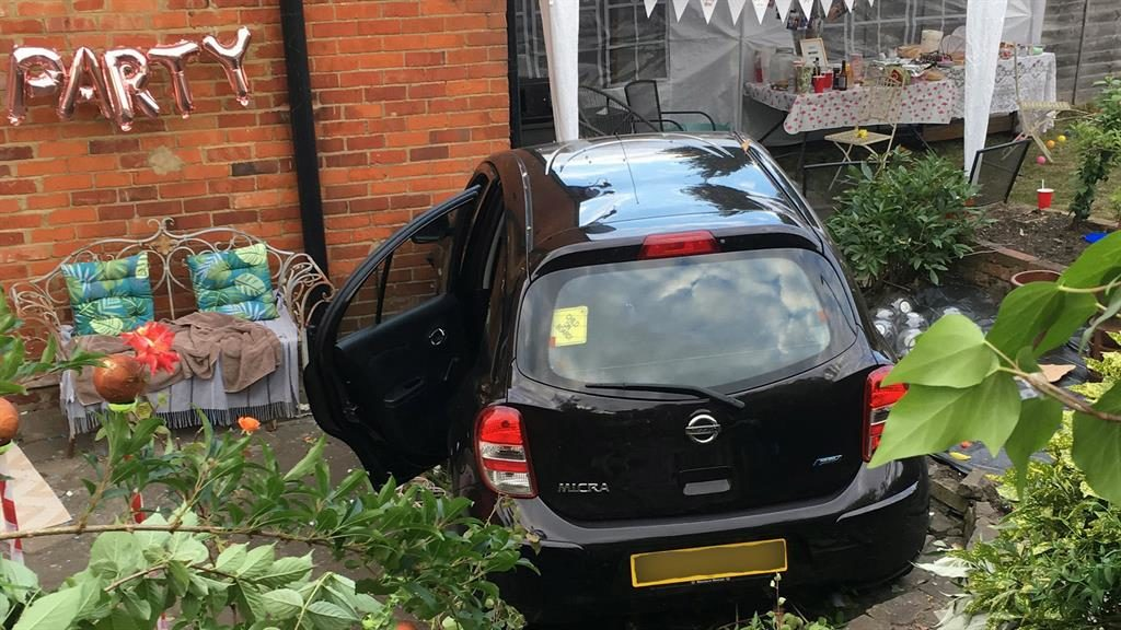 Making an entrance: The car ended up just inches from where children were playing