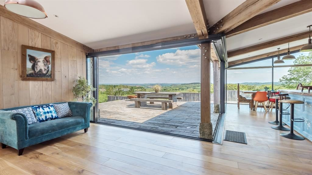 Breathtaking: The far-reaching views from inside and, below, the house from outside