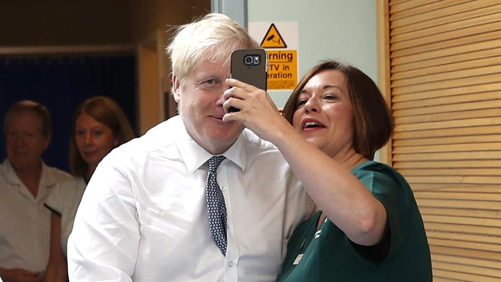 Photo opportunity: Boris Johnson with a member of the Pilgrim Hospital staff PICTURE: AP