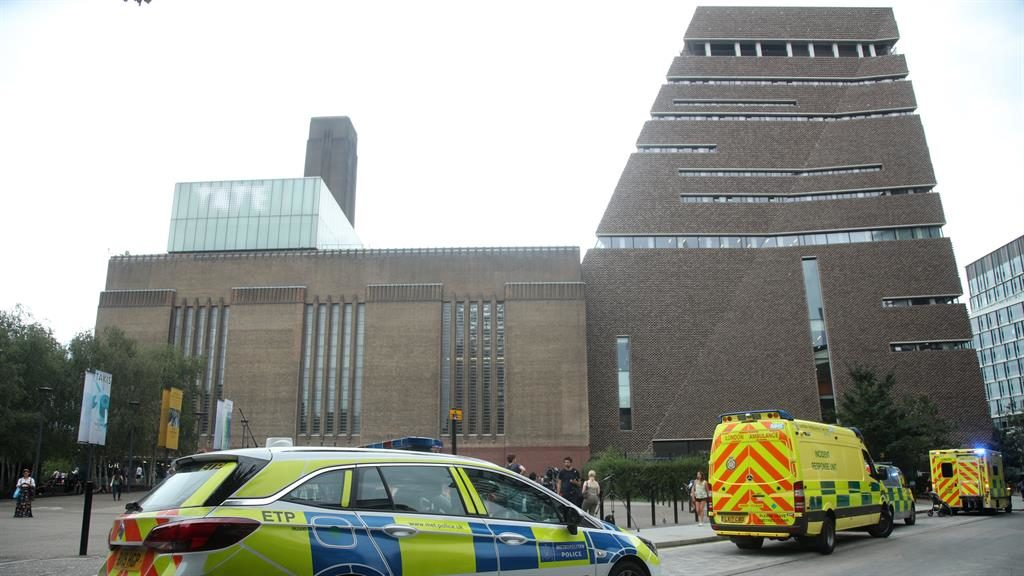 Visit horror: Emergency crews at Tate Modern, where boy was thrown off viewing platform. A teenager has appeared in court PICTURE: PA