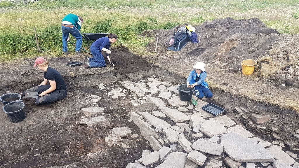 Digging inn: Archaeologists uncover the drinking hall's stone remains PICTURES: PA