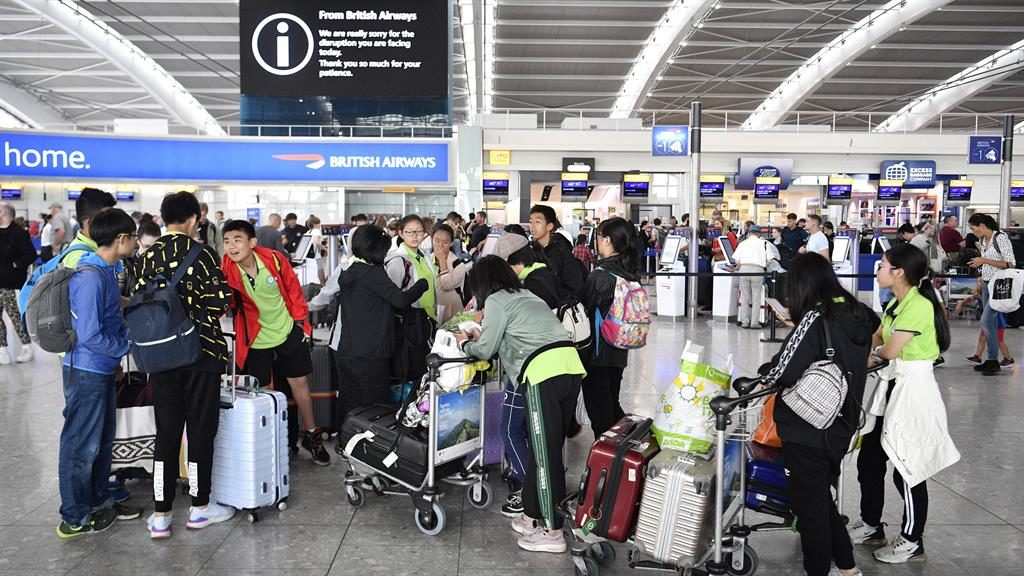 Stranded: Passengers wait in the departure lounge at Heathrow after cancellations PICTURE: EPA