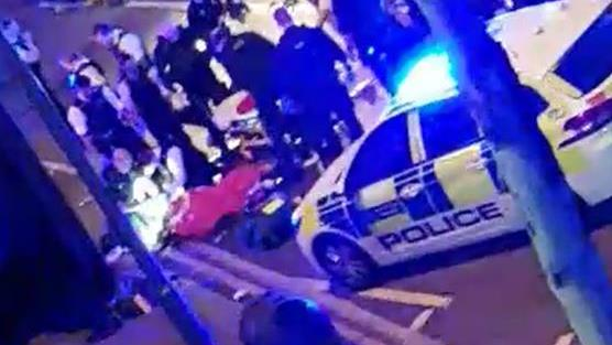'Frenzied attack': Police and ambulance services treated the injured officer at the scene in Leyton, east London