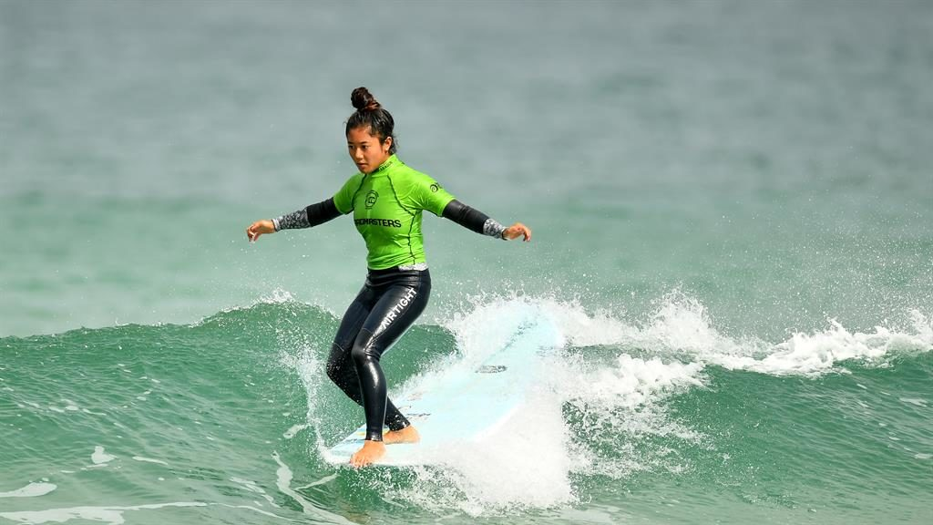 Having a squall: Natsumi Taoka from Japan competes at the Boardmasters Surf Festival in Newquay PICTURE: DAN MULLAN/GETTY
