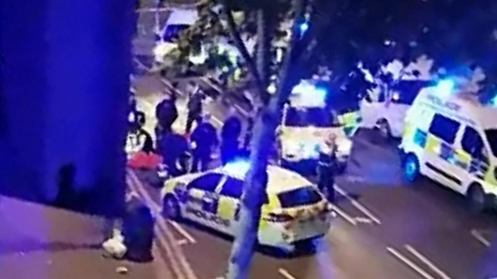 'Frenzied': Police and paramedics rush to the injured officer's aid after the attack PICTURE: SWNS