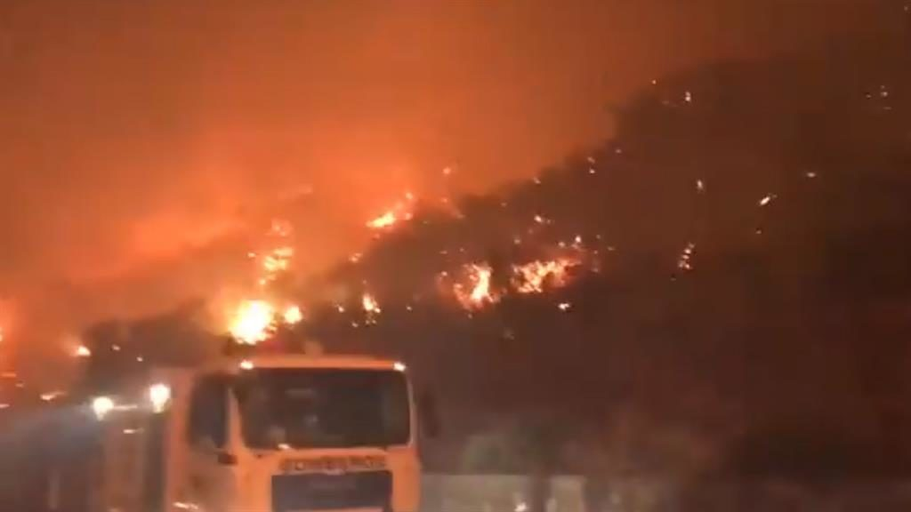 Destruction: Hills ablaze around Artenara, forcing islanders out of homes. A man, 55, has been arrested