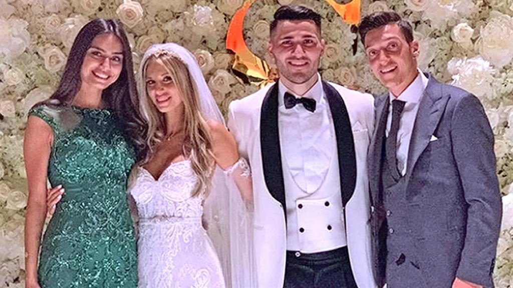 Best friends: (l-r) Amine Gulse, Bella and Sead Kolasinac, with Mesut Ozil PICTURES: ENTERPRISE