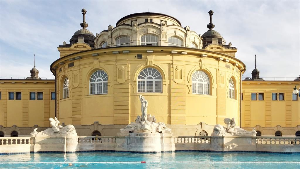 Mellow yellow: Széchenyi thermal bath in Budapest, the city where Wally (below) proposed to his wife, Amanda PICTURES: WALLY KOVAL