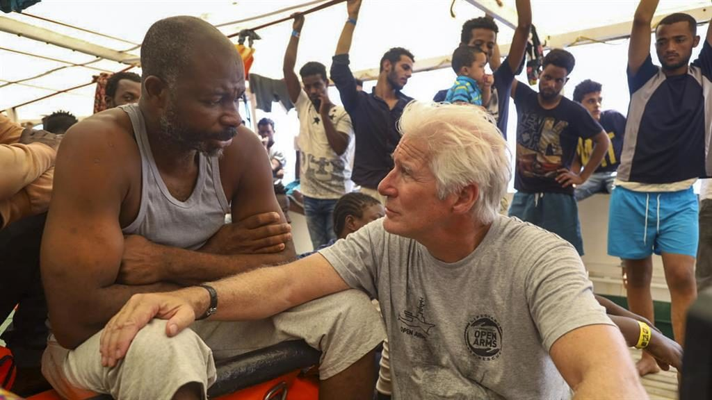 Rebuke: Gere talks with migrants PICTURE: AP