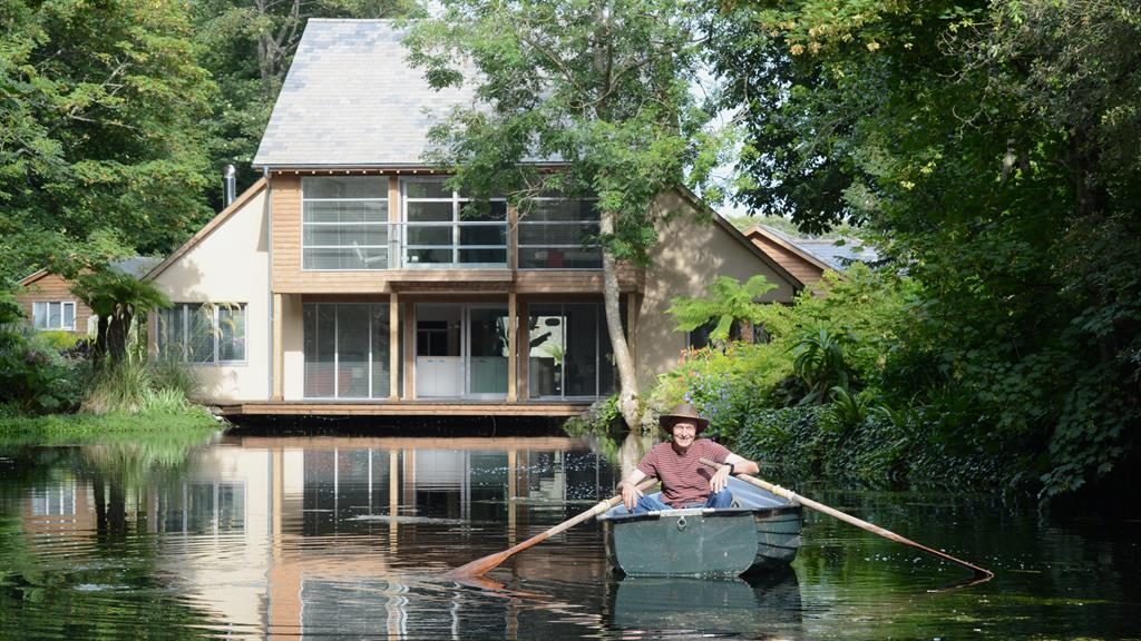 Oar-some view: Steve takes to the water in front of Haddon Lake House