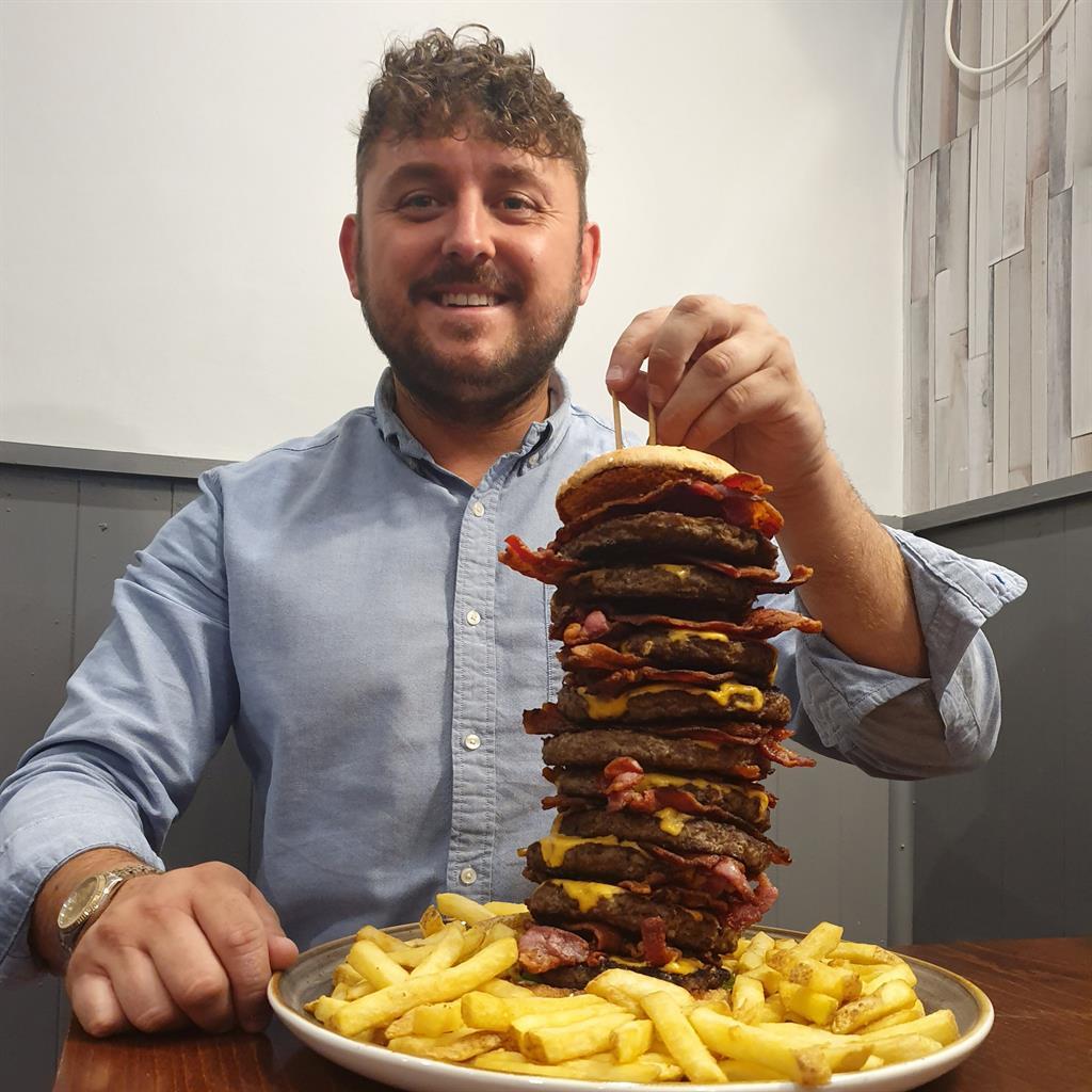 Grub's up: Pub owner Craig Harker, 32, with the Big Ben 10 burger
