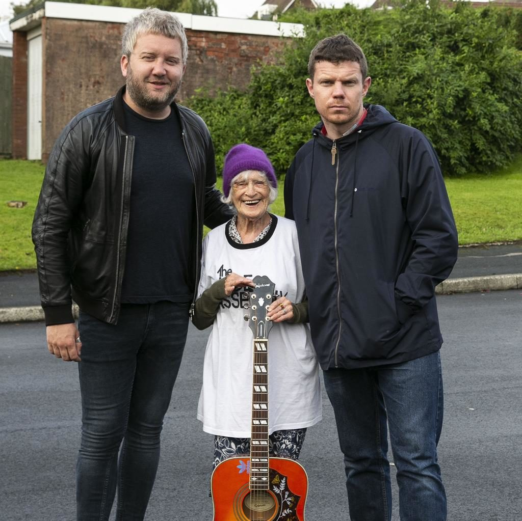 In tune: Chrissie with John (left) and guitarist Gareth Smedley PICTURE: SWNS