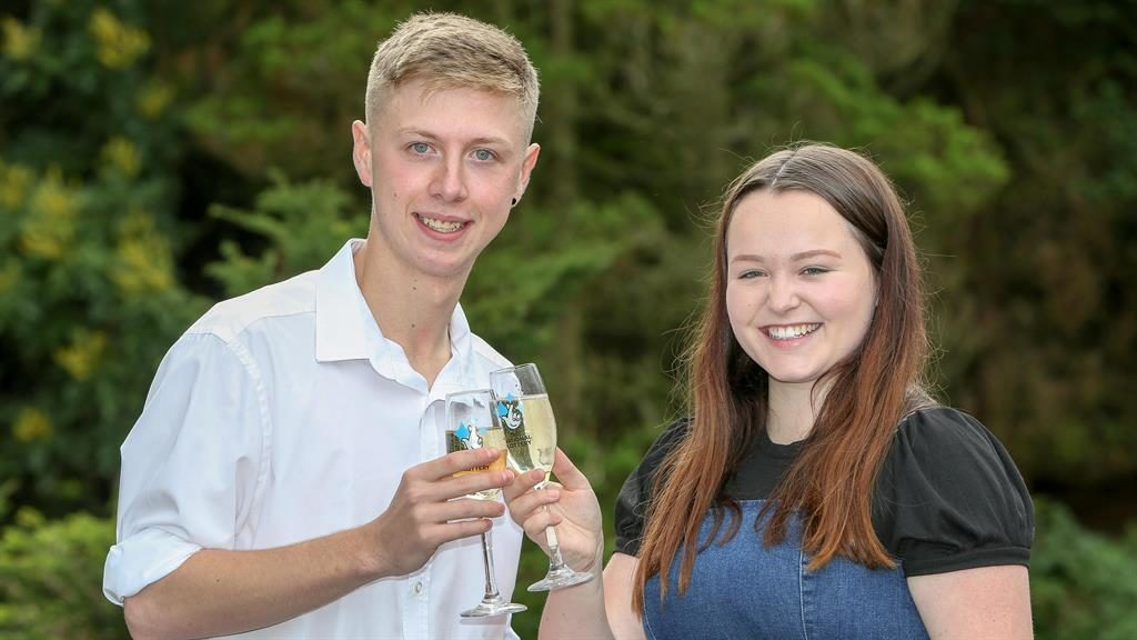 Cheers: Sam toasts windfall with partner Connie PICTURE: SWNS