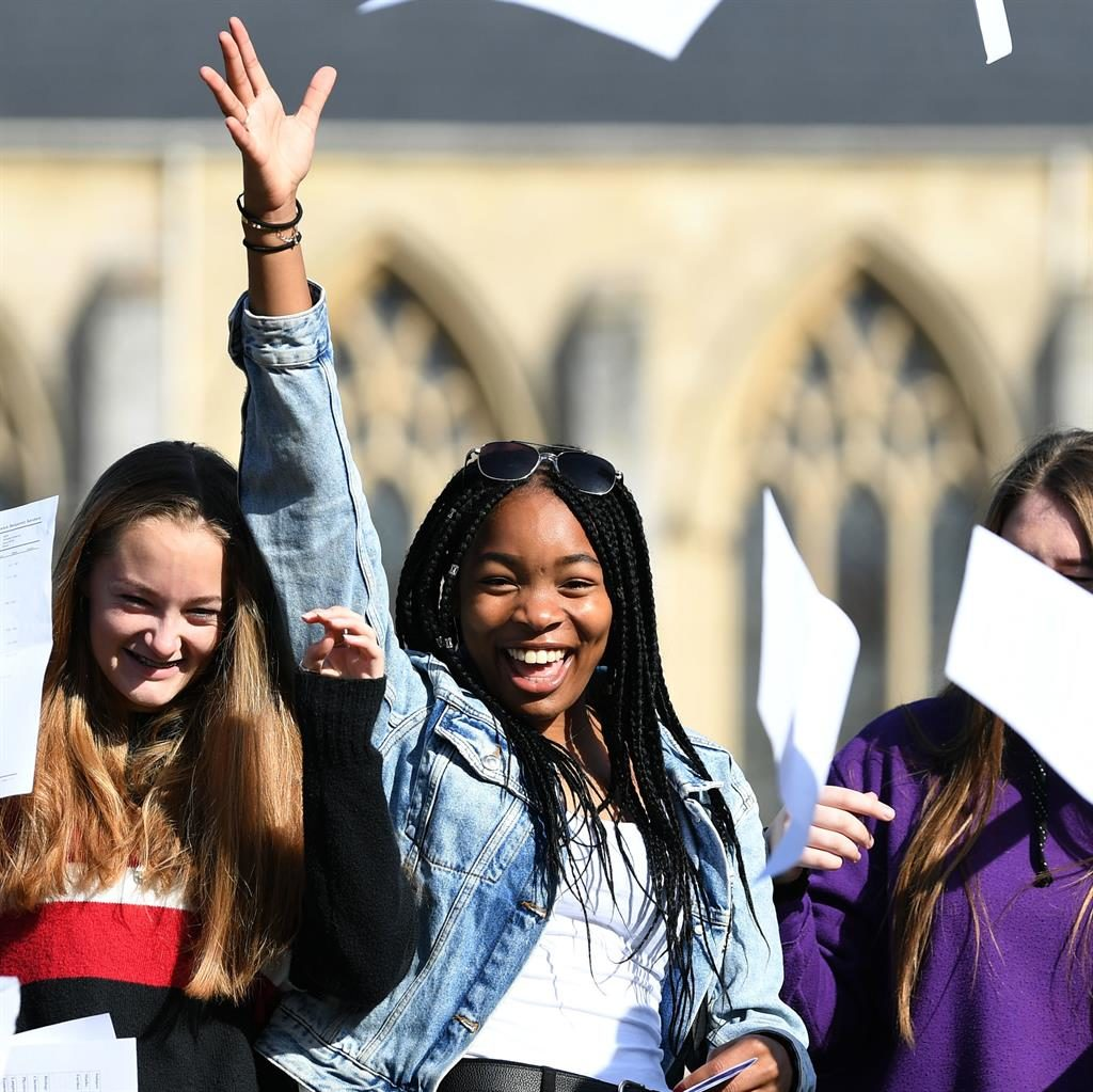 Schools out: Somoto Elumogo celebrates her results at Norwich School, Norfolk PICTURE: PA